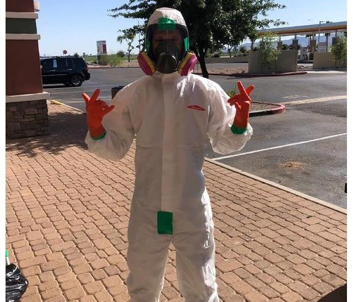 COVID DISINFECTION - image of employee in PPE